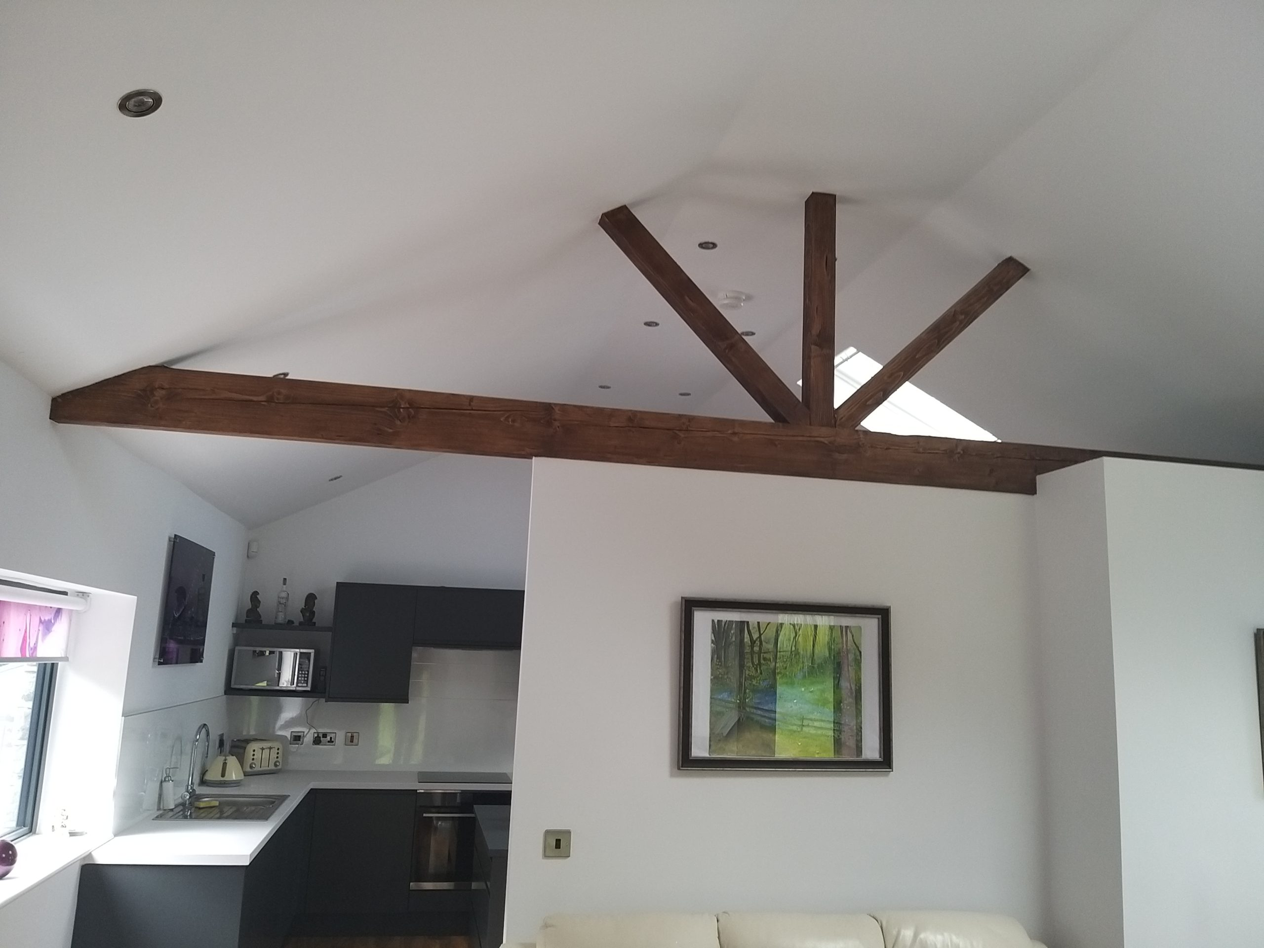 Wooden joist beams in a garage conversion