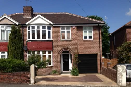 Double storey side extension with garage in Leeds