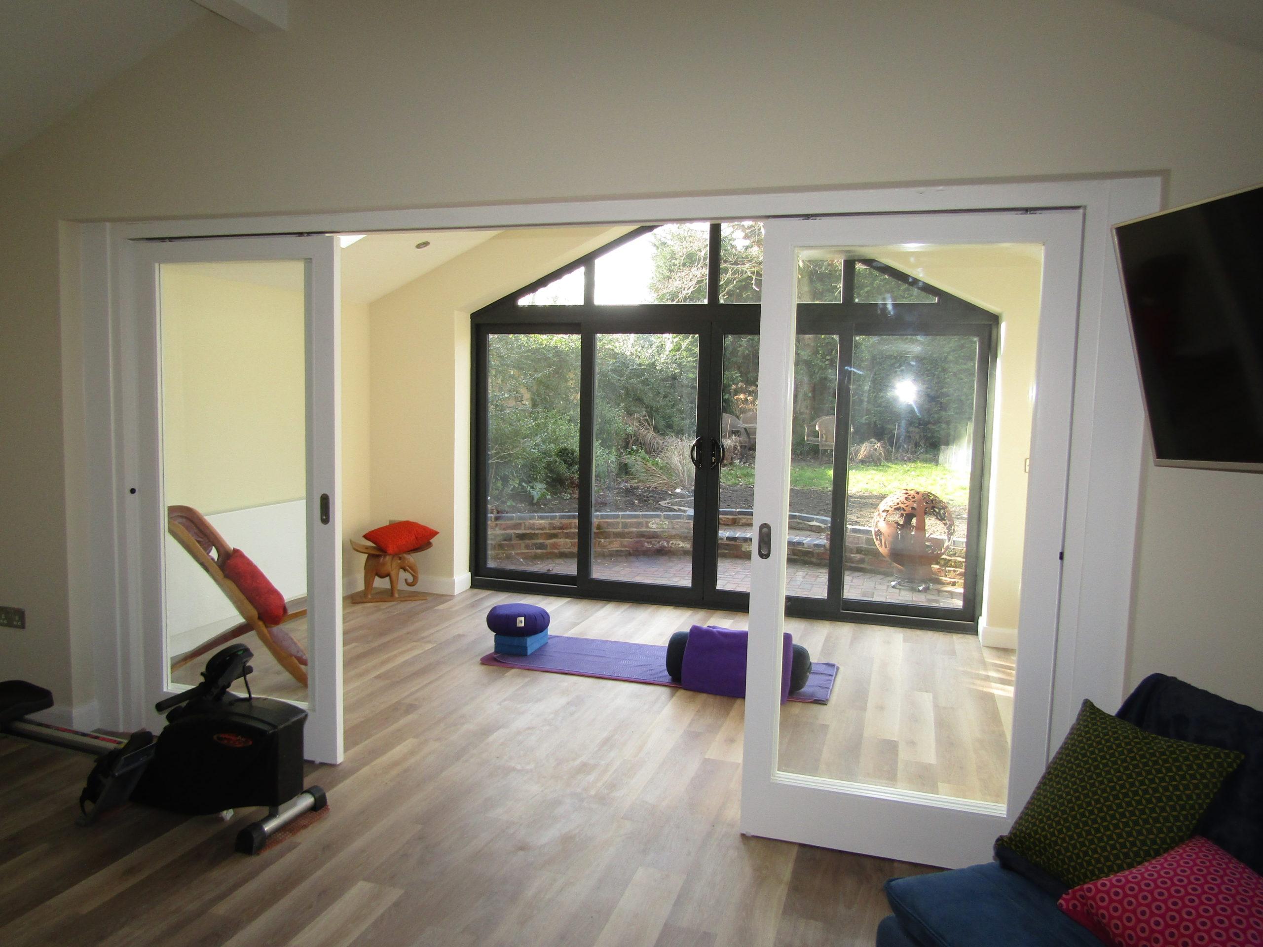 wide double doors inside open garage conversion
