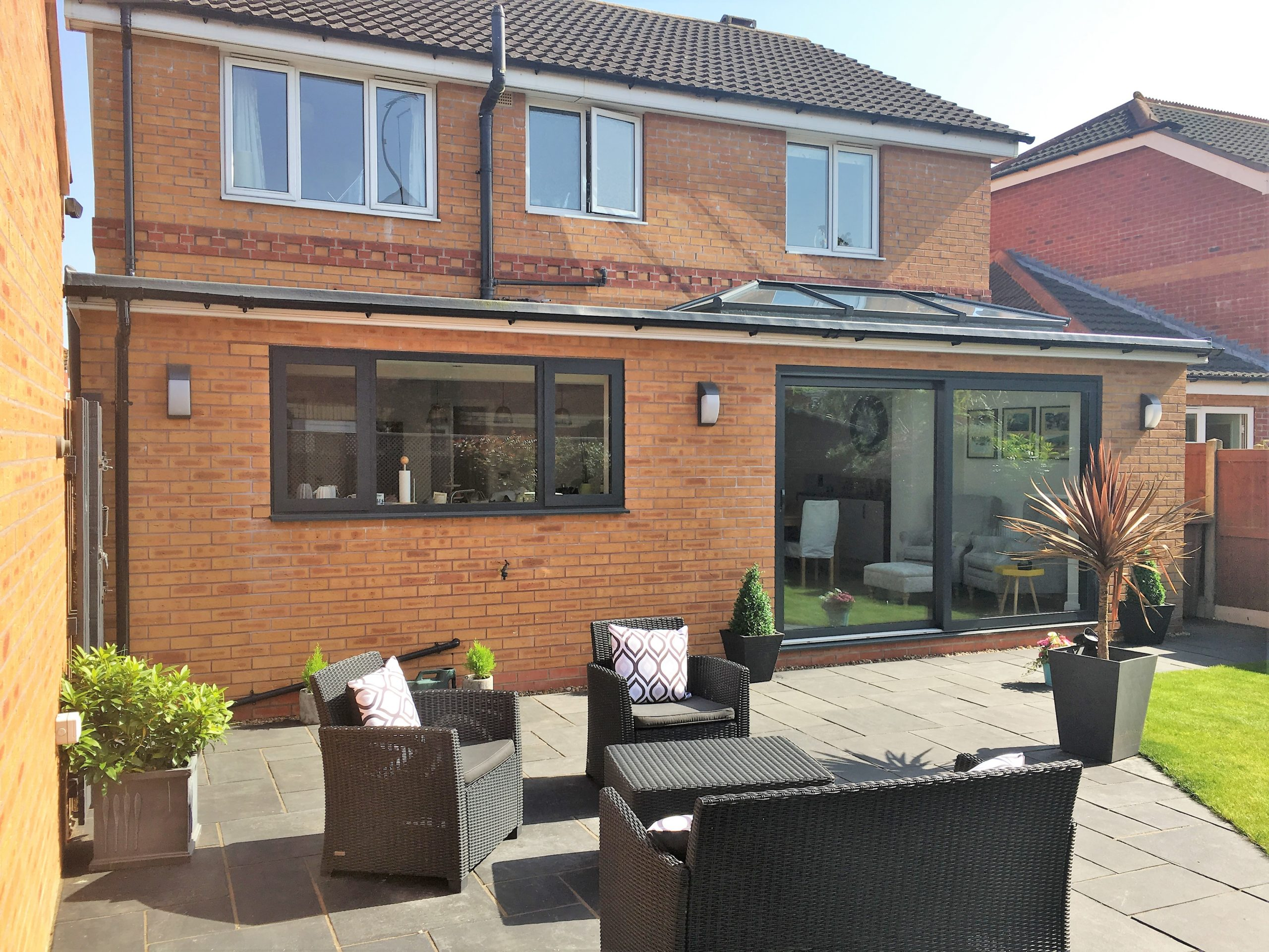 View of single storey extension and lawn furniture