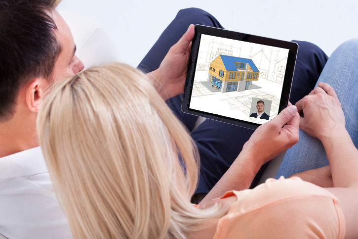 Couple reviewing architectural designs online