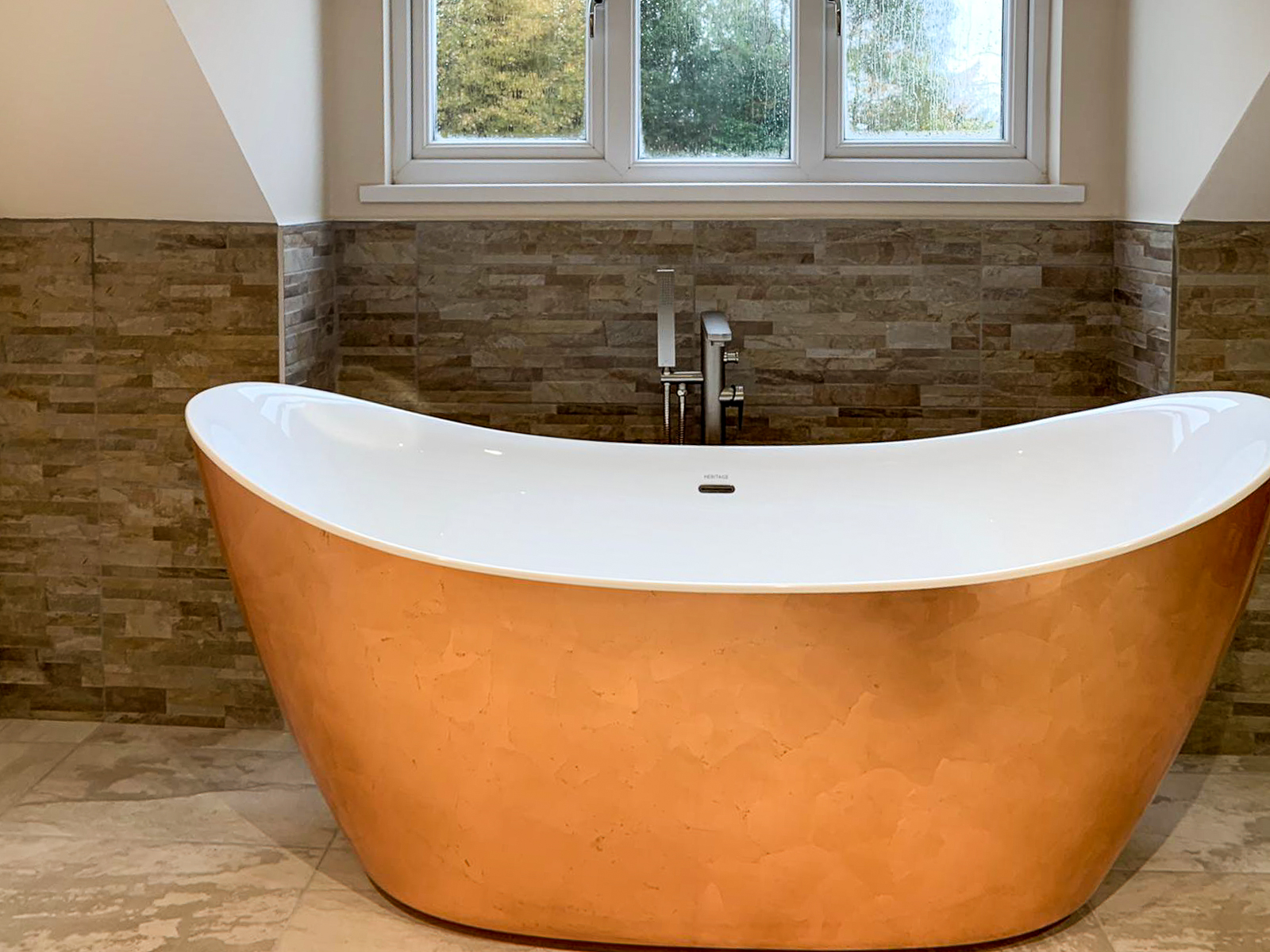 bronze bathtub inside new bathroom