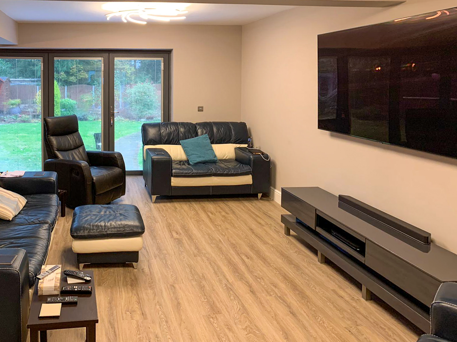 Living and seating area with entertainment system in double storey extension