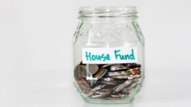 House fund jar with money inside