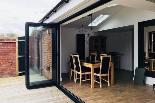 Single storey house extension with bifold doors open in Bradford